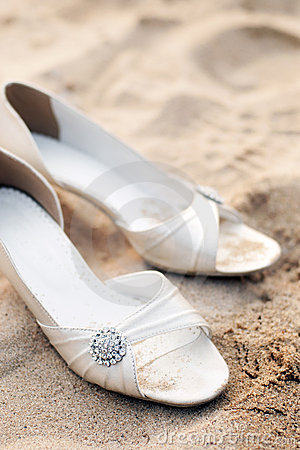 Bridal shoes on beach wedding party