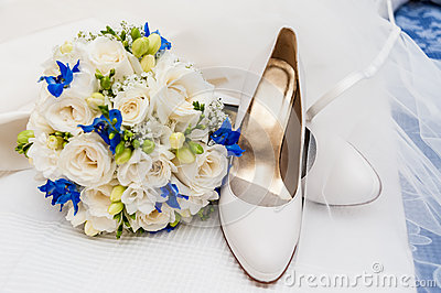Bridal shoes, veil and wedding bouquet