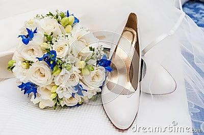 Bridal shoes, veil and wedding bouquet