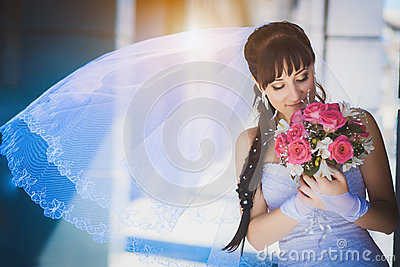 Bride against a blue modern building