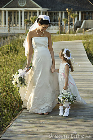 Free Bride And Flower Girl Walking. Stock Photos - 2038263