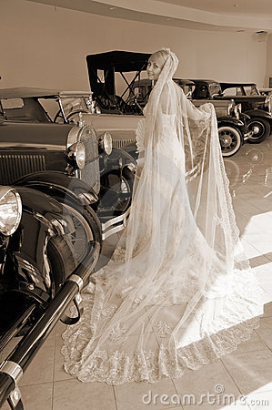 Bride and antique cars