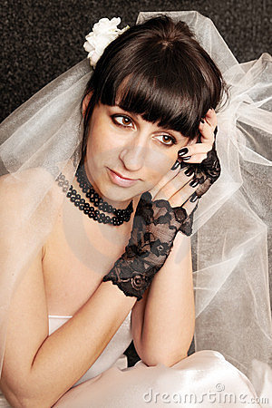 Bride in the black gloves