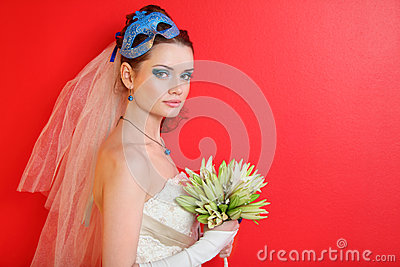 Bride with blue makeup and mask in hairdo