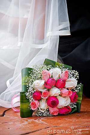 Bride, bridegroom and bouquet