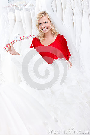 Bride is choosing the dress to try on