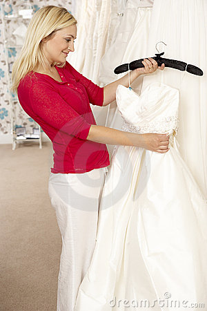 Bride choosing wedding dress