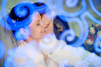 Bride with closed eyes and groom
