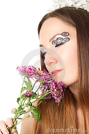 bride with creative make-up, body art and flowers
