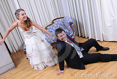 Bride draging the groom into marriage