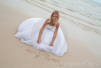 Bride drawing on the sand