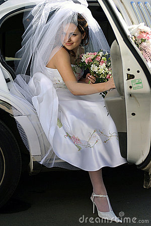 Bride exiting wedding car limo