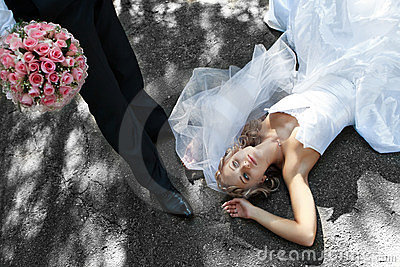 Bride is falling at groom s feet