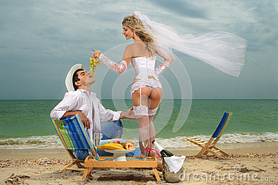 Bride feeding her groom with grapes