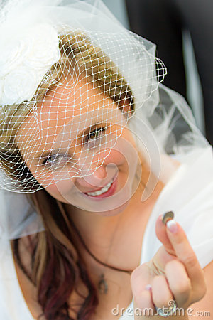 The bride find a lucky coin