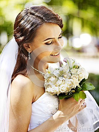 Bride with flower outdoor.