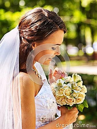 Bride with flower outdoor.