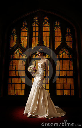 Bride in front of stained glass window