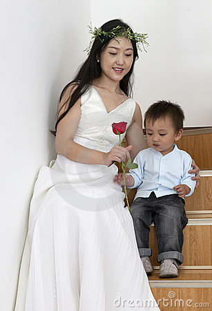 Bride giving son a rose