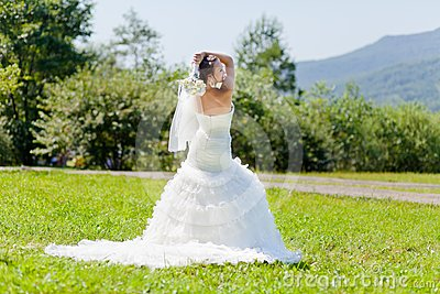 Bride at green grass