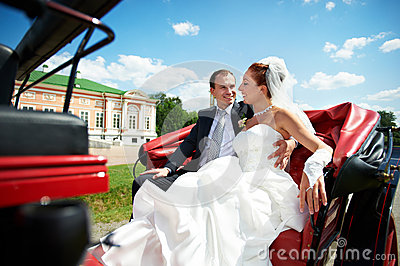 Bride and groom in beautiful carriage