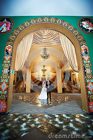 Bride and groom in beautiful interiors
