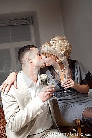 Bride and groom in bedroom