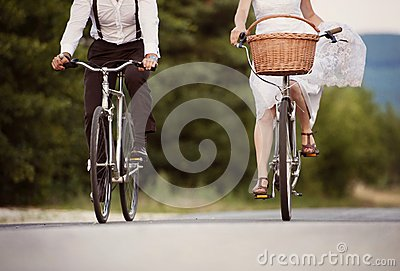 Bride and groom on the bikes