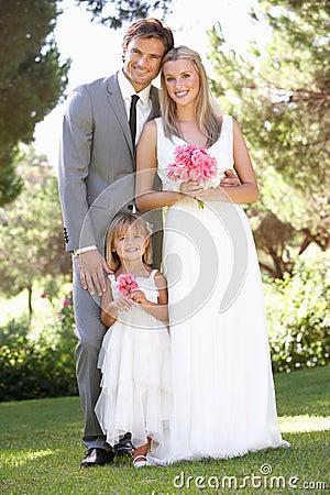 Bride And Groom With Bridesmaid At Wedding