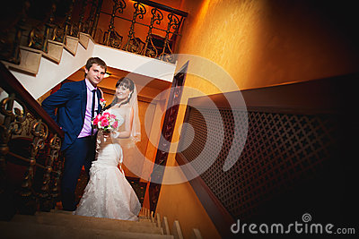 Bride and groom in the classic english interior