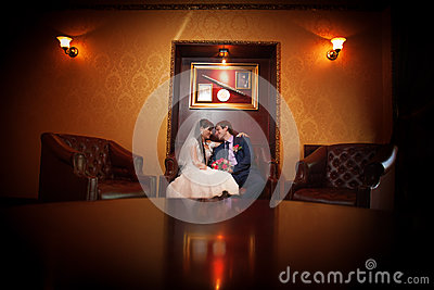 Bride and groom in the classic interior