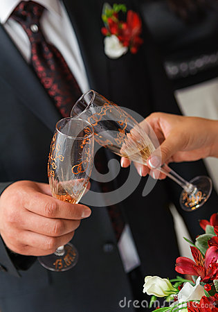 Bride and groom a clink glasses. Wedding couple