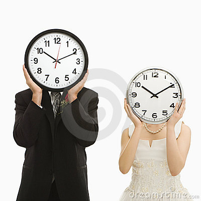Bride and groom with clocks.