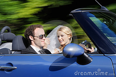 Bride and groom driving to their bright future