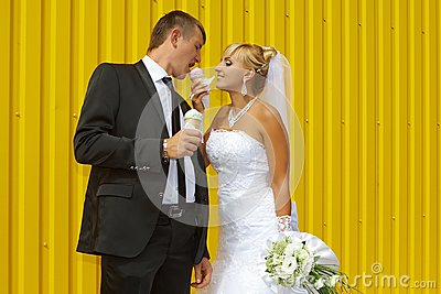 The bride and groom eat ice cream