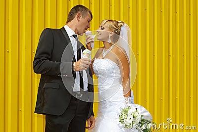 The bride and groom eat ice cream