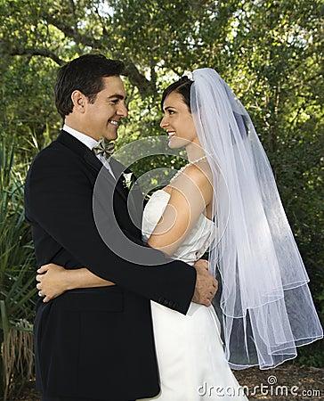 Bride and groom embracing.