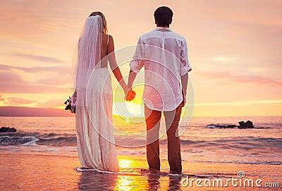 Bride and Groom, Enjoying Amazing Sunset on a Beautiful Tropical beach