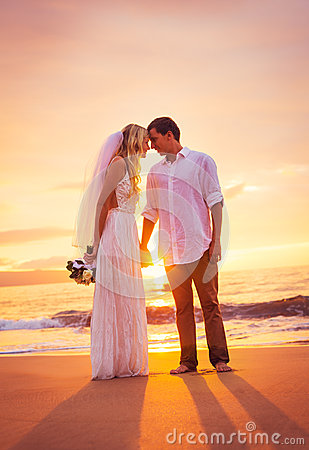Bride and Groom, Enjoying Amazing Sunset on a Beautiful Tropical