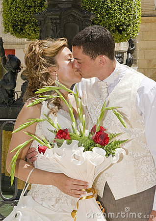 Bride and Groom exchanging a kiss