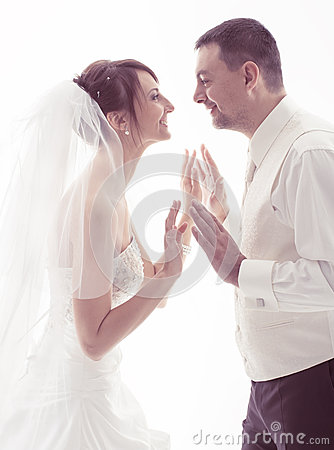 Bride and groom face to face on white background