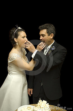 Bride and Groom feeding eachother cake