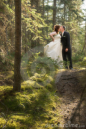 Bride and Groom in Forest with Soft Focus