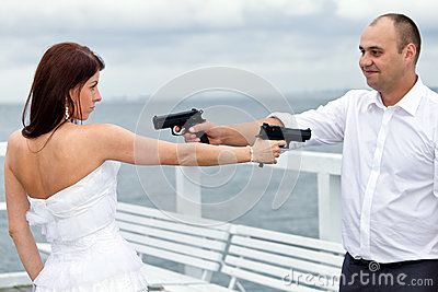 Bride and groom with guns