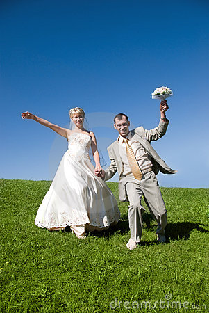 Bride and groom on the hill