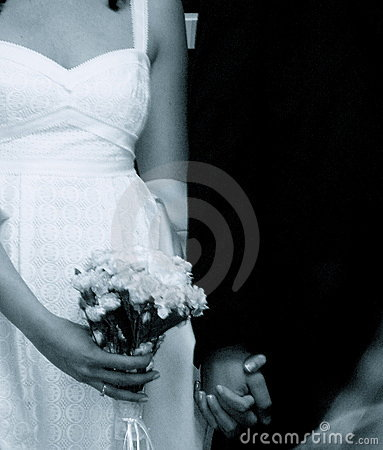 Bride and Groom Hold Hands; Bride Holds Bouquet