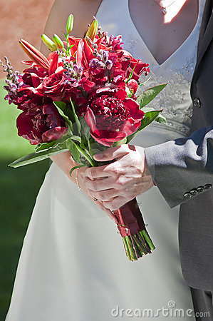 Bride and Groom holding Rose