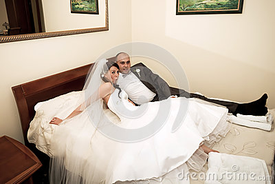 Bride and groom in the hotel bed