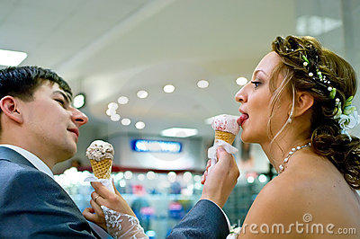 Bride and groom with ice-cream