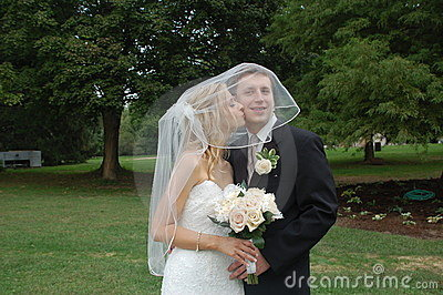 Bride and Groom Kiss on Cheek